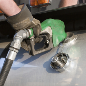 Trucker pumping gas and using ExpressIFTA for IFTA fuel tax reporting