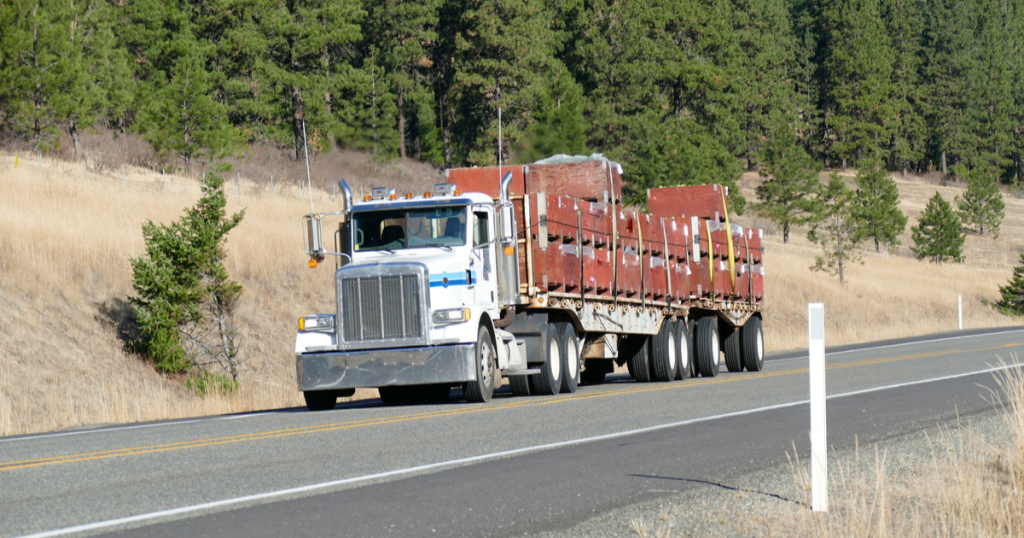 Truck with flatbed using ExpressIFTA for 4th quarter IFTA reporting