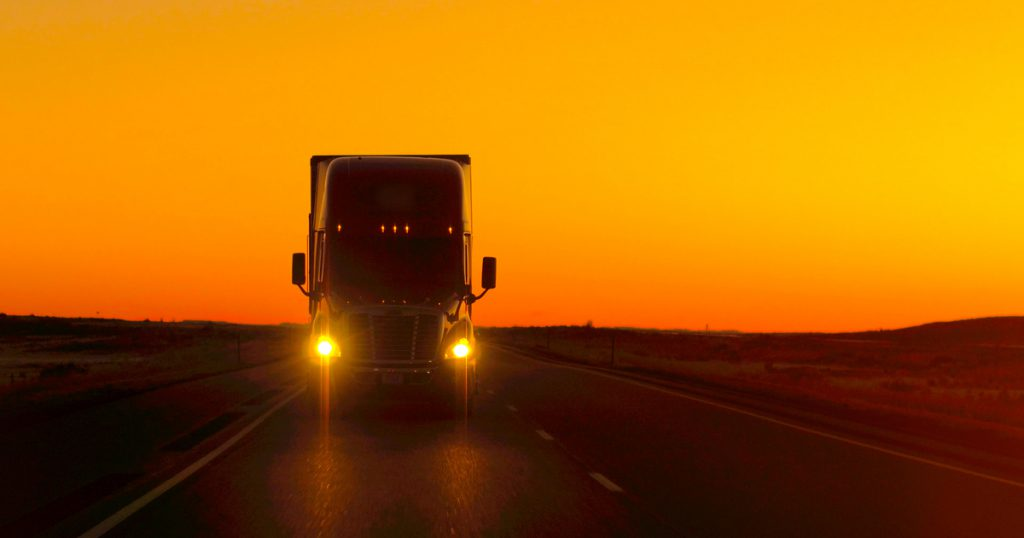 Truck at sunset using TruckLogics for IFTA reporting