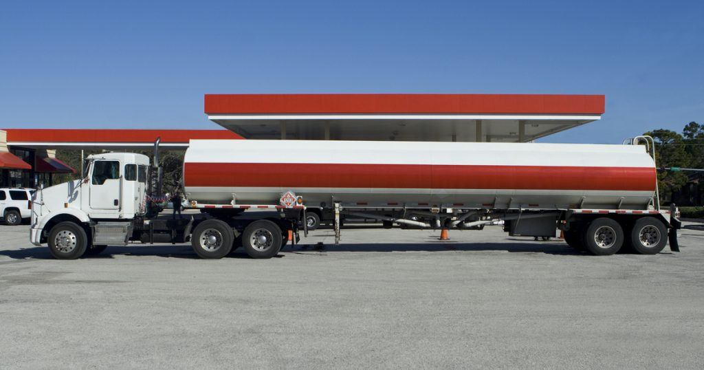 Tanker truck at gas station filing nontaxable IFTA miles